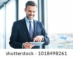 smiling businessman using... | Shutterstock . vector #1018498261