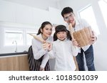 happy asian family with little... | Shutterstock . vector #1018501039
