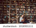 reading books lovely young... | Shutterstock . vector #1018501111