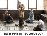 female instructor helping woman ... | Shutterstock . vector #1018506307
