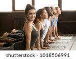 smiling yoga instructor looking ... | Shutterstock . vector #1018506991