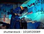 welder welding with welding... | Shutterstock . vector #1018520089