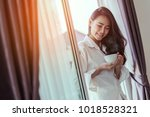 asian woman drinking coffee in...   Shutterstock . vector #1018528321