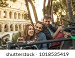 three young friends tourists... | Shutterstock . vector #1018535419