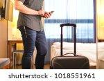 man using smartphone in hotel... | Shutterstock . vector #1018551961