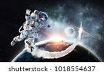 spaceman and his mission. mixed ... | Shutterstock . vector #1018554637