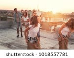 group of young people having... | Shutterstock . vector #1018557781