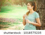 women are drinking cool water... | Shutterstock . vector #1018575235