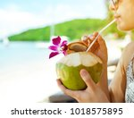 close up woman drink a coconut... | Shutterstock . vector #1018575895