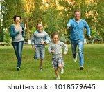 family in the green  summer park | Shutterstock . vector #1018579645
