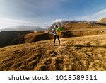 woman tourist with a big... | Shutterstock . vector #1018589311