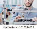 engineering student using a 3d... | Shutterstock . vector #1018594651
