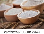 wooden bowls with different... | Shutterstock . vector #1018599631