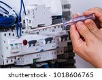 electrician at work with cables | Shutterstock . vector #1018606765