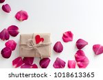 gift in craft paper with red... | Shutterstock . vector #1018613365