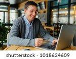 handsome man holding credit...   Shutterstock . vector #1018624609