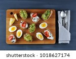 canape sandwiches on a wooden... | Shutterstock . vector #1018627174