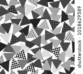 chaotic patterned triangles... | Shutterstock . vector #1018629589
