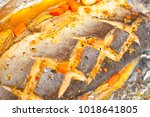 baked fish in aluminum foil | Shutterstock . vector #1018641805