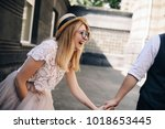 the charming bride and groom... | Shutterstock . vector #1018653445