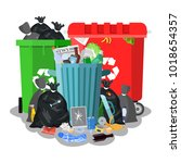 steel garbage bin full of trash.... | Shutterstock .eps vector #1018654357