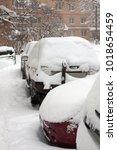 cars after snowfall | Shutterstock . vector #1018654459