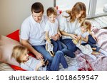 happy family having fun... | Shutterstock . vector #1018659547