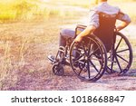 paralyzed man using wheelchair...   Shutterstock . vector #1018668847