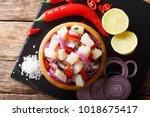 freshly prepared ceviche from... | Shutterstock . vector #1018675417