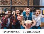 emotional young multiethnic... | Shutterstock . vector #1018680535