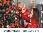 the mother and father hold on... | Shutterstock . vector #1018692571