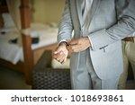 man wearing western formal grey ... | Shutterstock . vector #1018693861