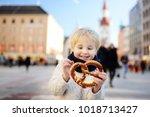 little tourist holding... | Shutterstock . vector #1018713427