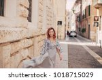 smiling elegant girl in... | Shutterstock . vector #1018715029