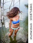 sexy girl in bikini posing in... | Shutterstock . vector #1018716661
