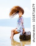 beautiful girl in a lake with... | Shutterstock . vector #1018716679