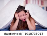 close up of woman with her head ... | Shutterstock . vector #1018735015