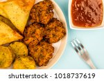 indian food style snacks... | Shutterstock . vector #1018737619