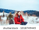 the guy sitting in the snow   Shutterstock . vector #1018749445