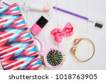 pink toiletry bag and makeup... | Shutterstock . vector #1018763905