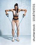 fitness girl performs exercises ... | Shutterstock . vector #1018765531