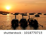 silhouetted longtail boats at... | Shutterstock . vector #1018770715