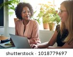 two smiling businesswomen... | Shutterstock . vector #1018779697