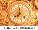 gold watch with roman numerals | Shutterstock . vector #1018787671