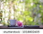 white cup with big pink rose at ... | Shutterstock . vector #1018802605