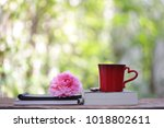 red coffee cup with big pink... | Shutterstock . vector #1018802611