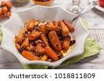 honey glazed baby carrots with... | Shutterstock . vector #1018811809