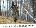 traveler carries a dry timber...   Shutterstock . vector #1018812025