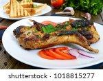 fried rabbit legs on a white... | Shutterstock . vector #1018815277