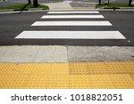 crosswalk with tactile paving... | Shutterstock . vector #1018822051